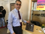 Michael Kasparian, CEO of the Falmouth Chamber of Commerce is also a Certified Antiques Appraiser.  Seen here checking out an item at the Falmouth Preservation Alliance Expo on 05-20-17.
