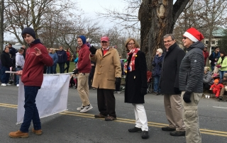 12-03-17 Falmouth Christmas Parade - Trent and Jacob Tessier carrying the banner. Members Kevin Doyle, Polly Thayer, Jay Thayer and Mike Herlihy.